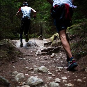 cropped men running in trails